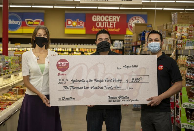 Jessica Bilecki of Pacific's food pantry with Ismael Villalba and Jesus Valenzuela, co-owners of the Grocery Outlet on North Wilson Way in Stockton.