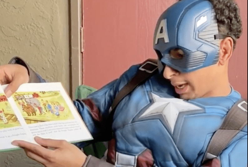 Ahmed Barnes '22 as Captain America reading The Little Engine that Could.