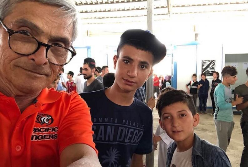 "During the filming of the documentary ""The Longest Road,"" Stan Rapada (left) met many children at Iraqi refugee camps."