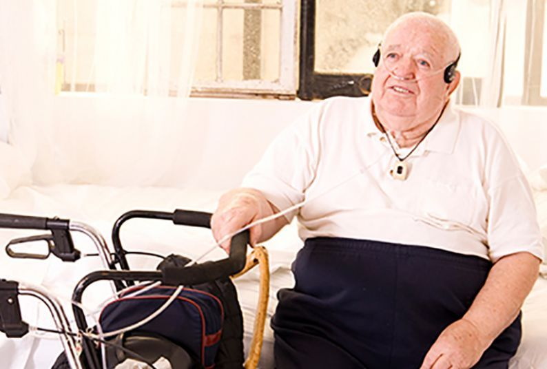 older man with assistive equipment