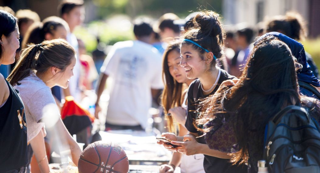 students learn about clubs and organizations at club fair