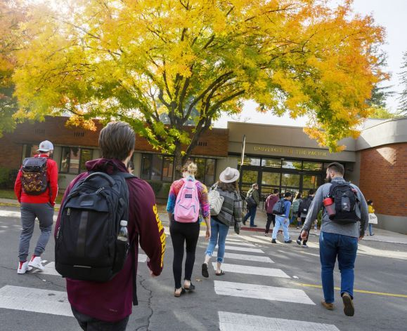 students walk to class on the Sacramento campus