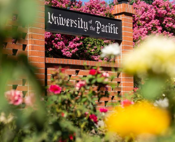 University of the Pacific sign surrounded by roses