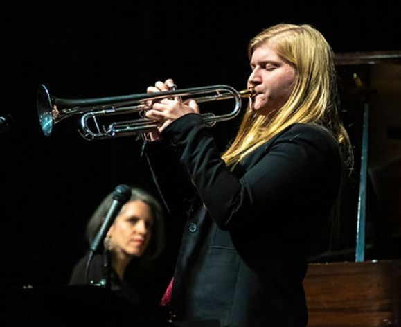 Kate Williams playing her trumpet